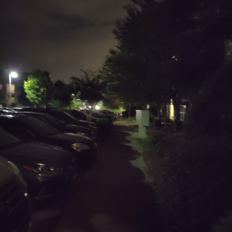 Sidewalk photographed at night