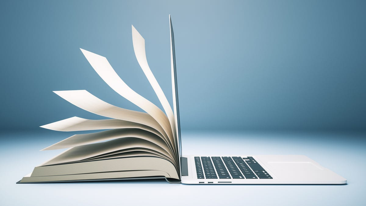 A laptop slowly turning into a book.