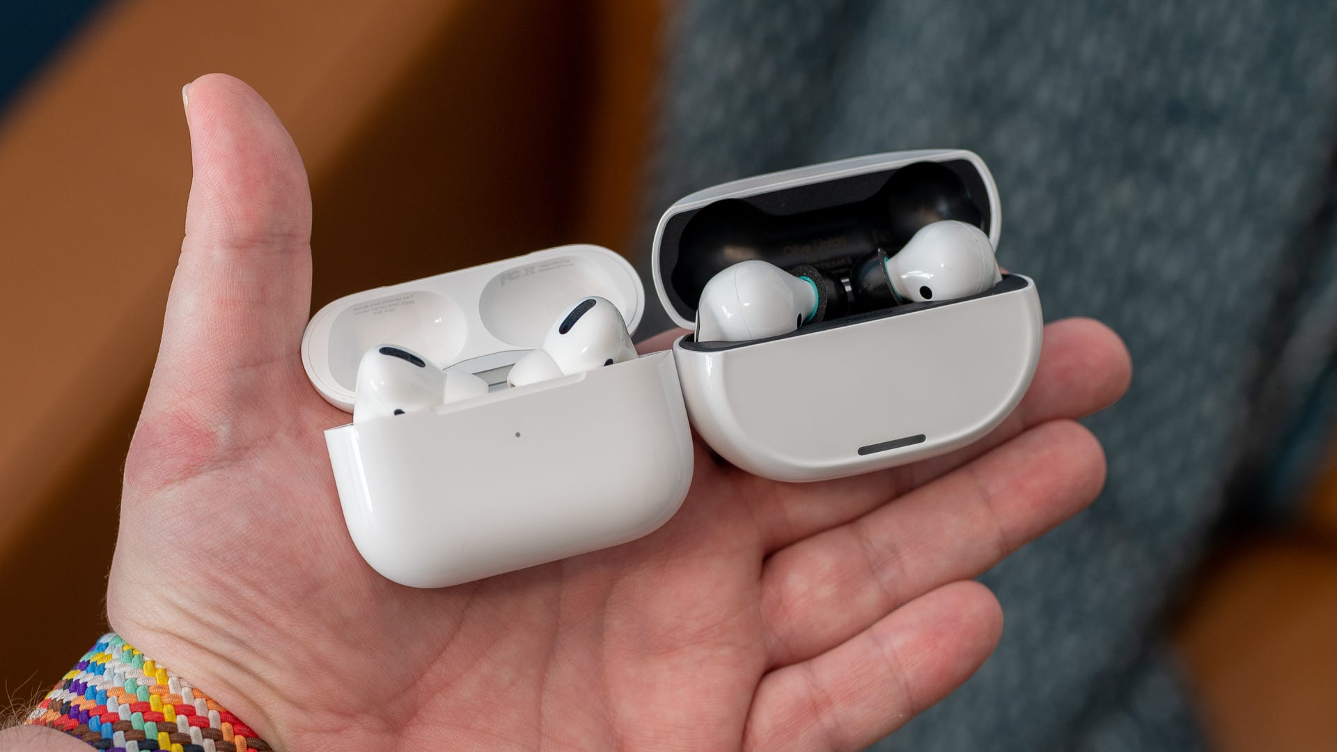 Two sets of wireless earbuds cases that are similar sized.