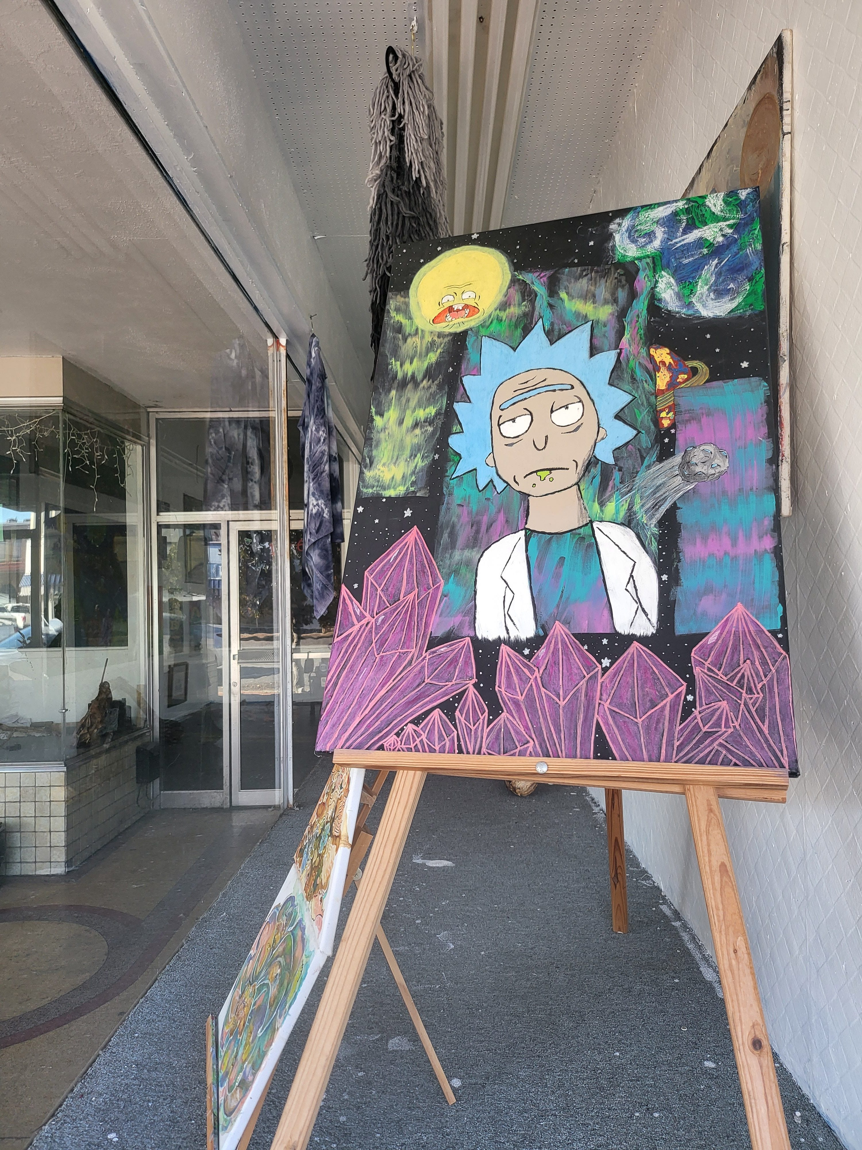 Rick and Morty painting in a shop window