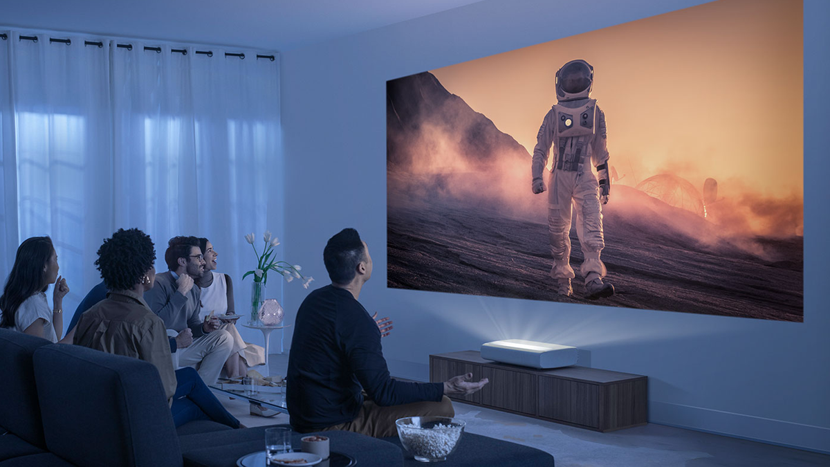 People watching a film with the Samsung Premiere projector.