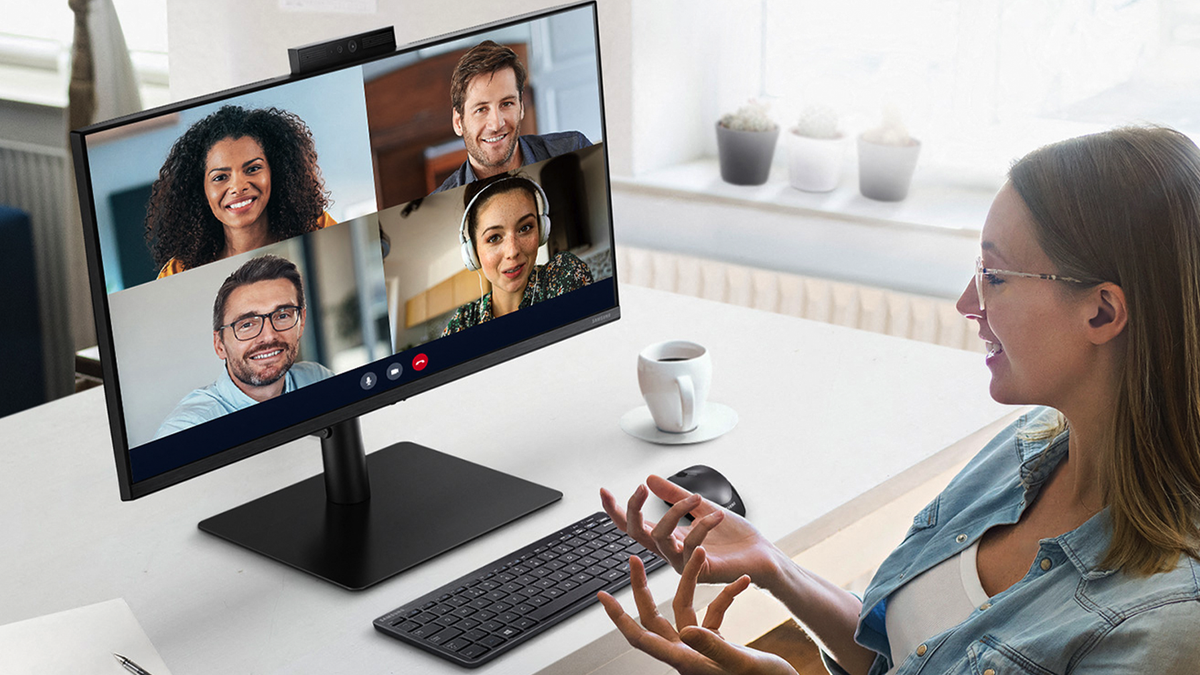 Someone using the Samsung Webcam Monitor S4's pop-up webcam for a video meeting.