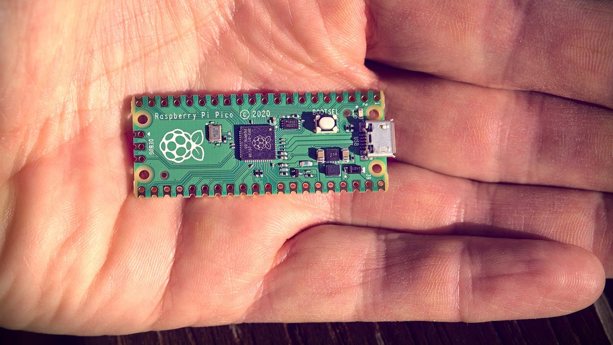 A Raspberry Pi Zero in the palm of a hand.