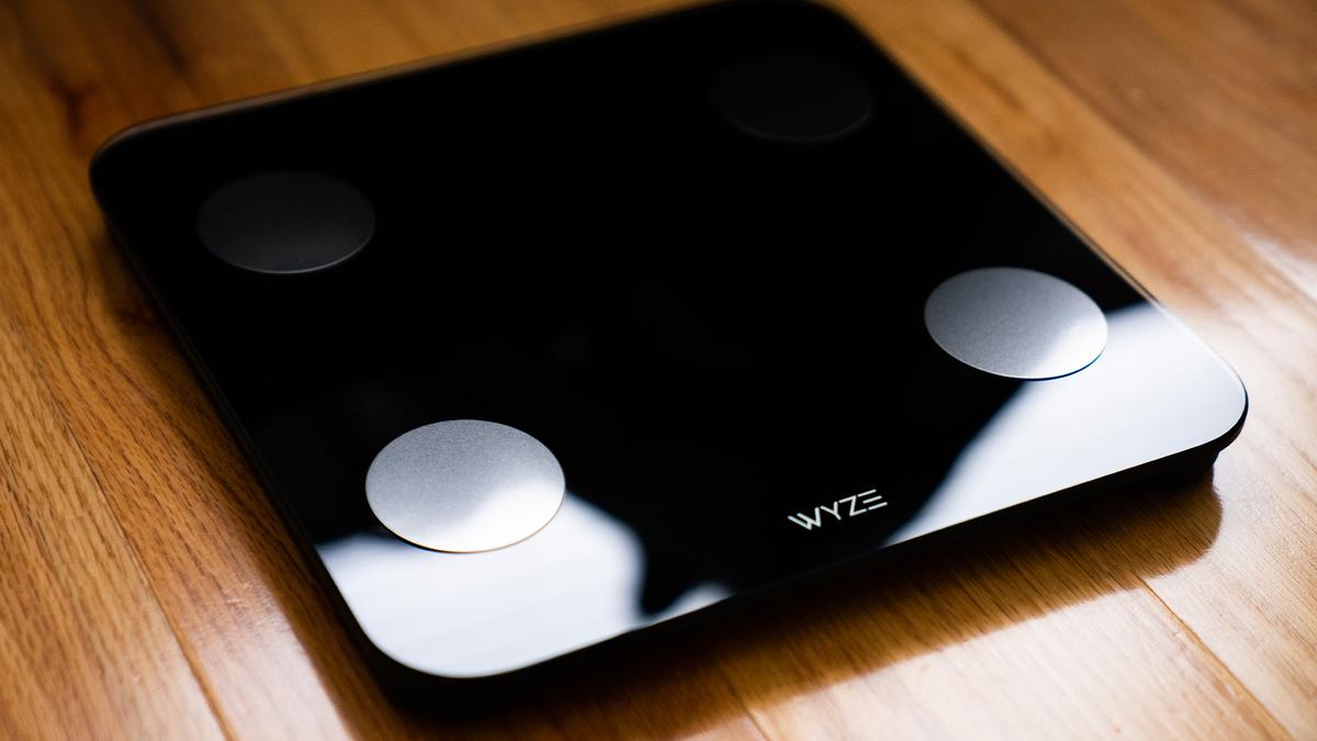 The Wyze Scale S on a hardwood floor.