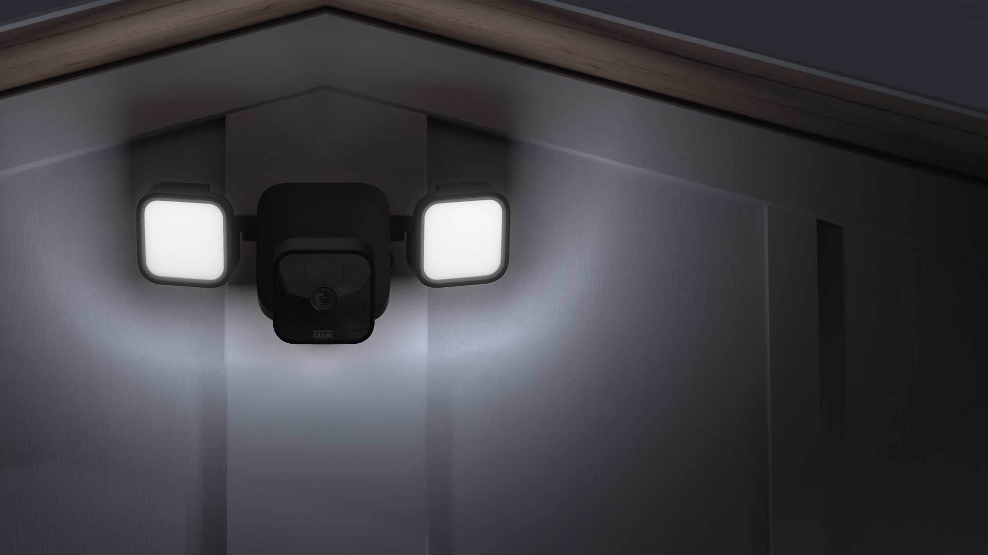 The Blink Floodlight Cam on the side of a home.