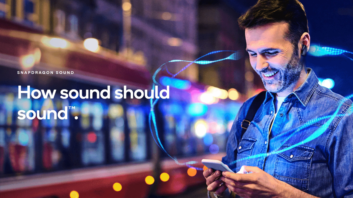 Qualcomm Snapdragon Sound logo and motto next to person listening to audio from smartphone in a city street