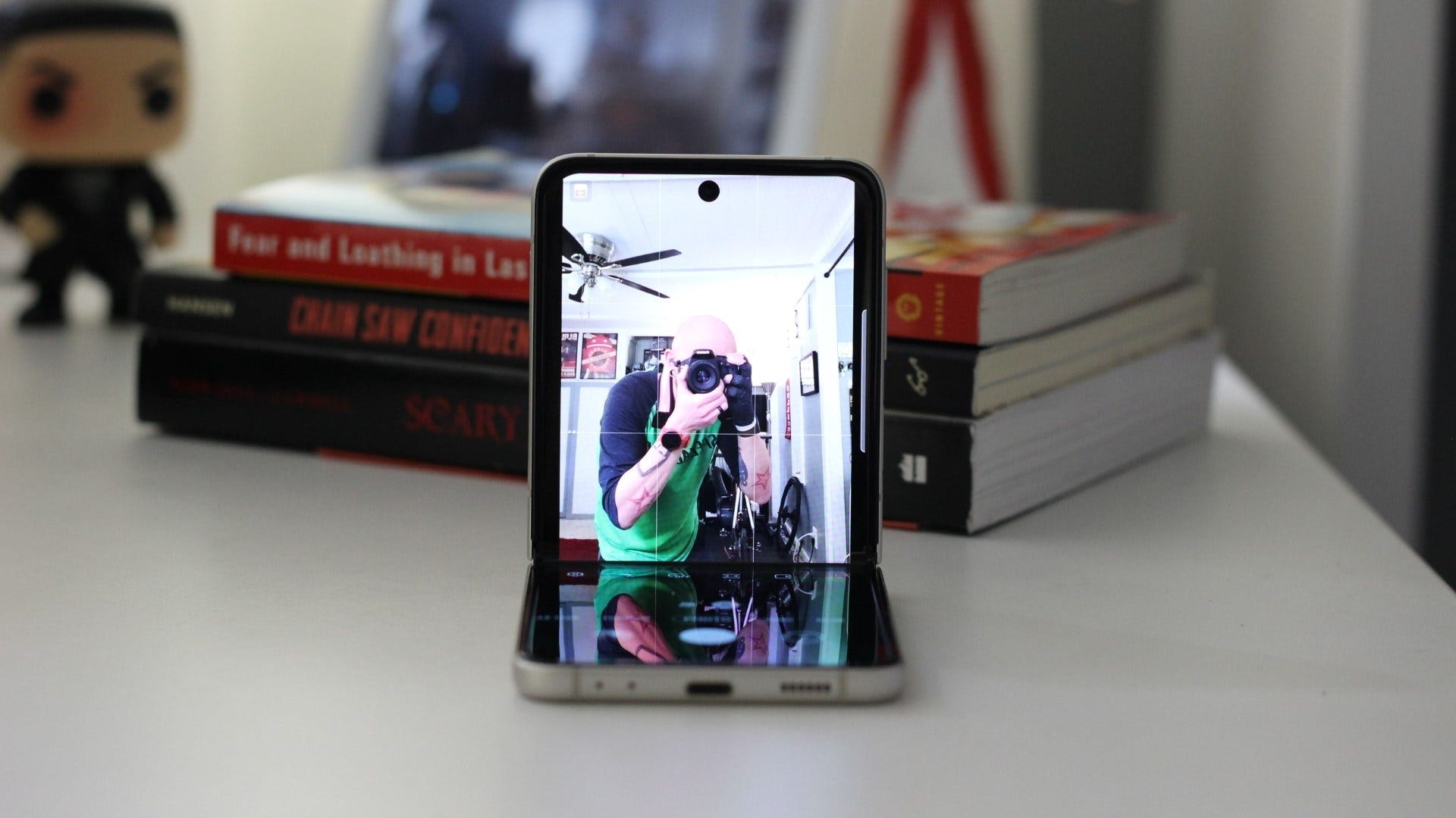 The Flip 3 open in flex mode, front camera active
