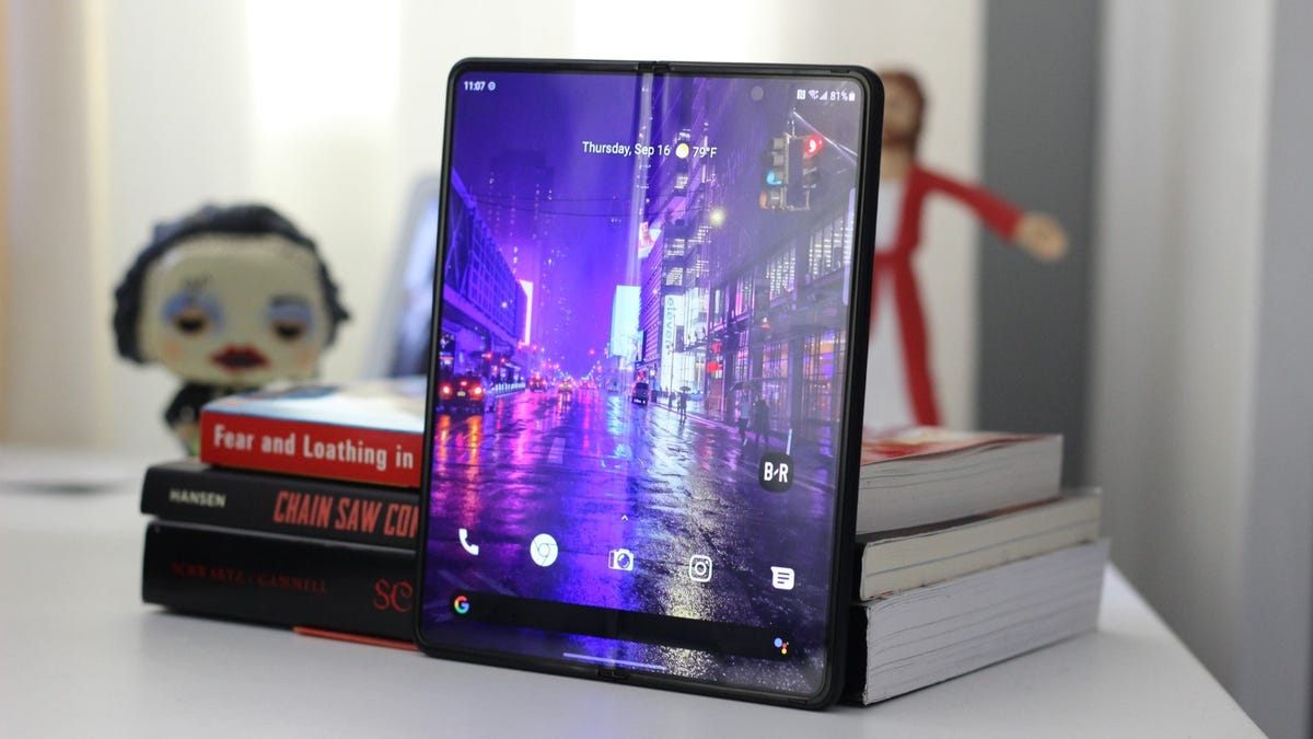 Galaxy Z Fold 3, opened leaning on some books