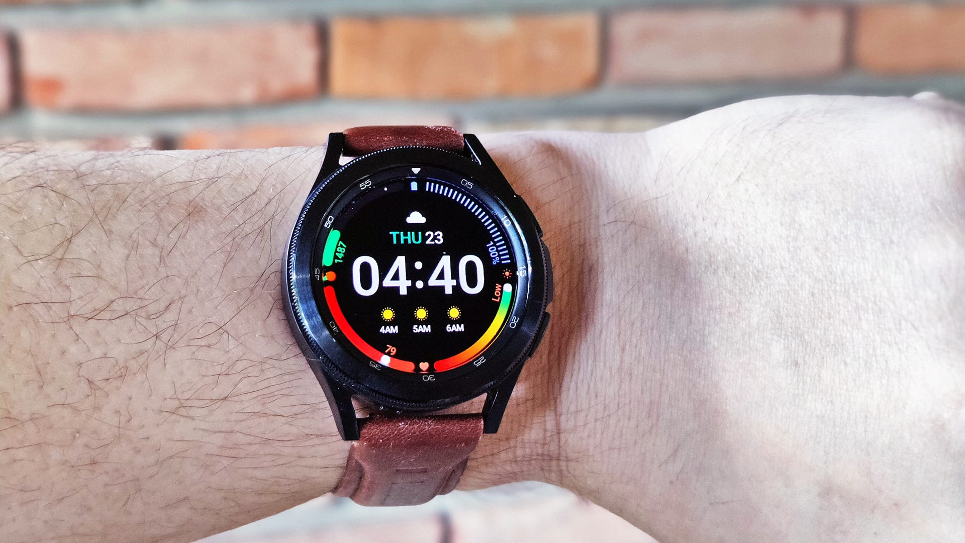A closeup of the Galaxy Watch 4 with a leather band.
