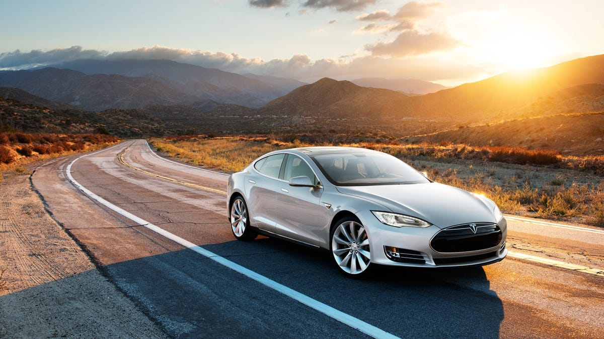 A Tesla driving down a windy road.
