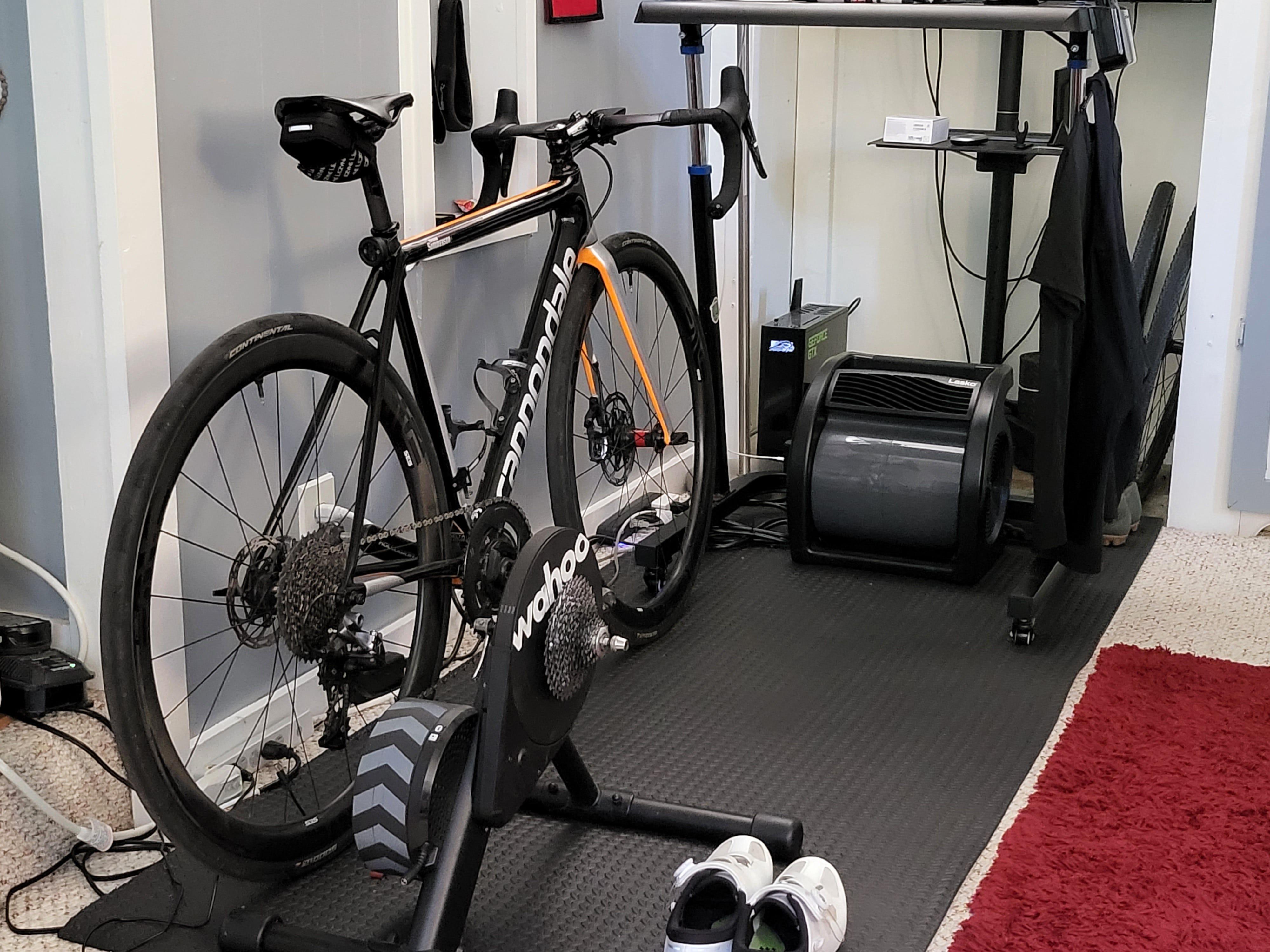 Indoor shot of a bike, trainer, shoes, etc.