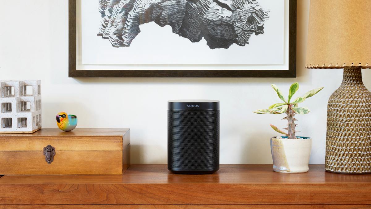 Sonos One speaker on a desk.
