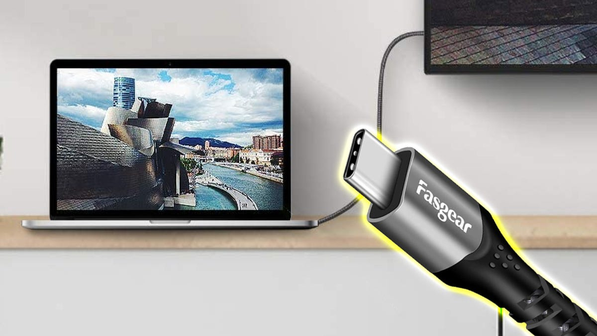 Illustration of USB-C Video Cables in front of a laptop on a shelf connected to a monitor.