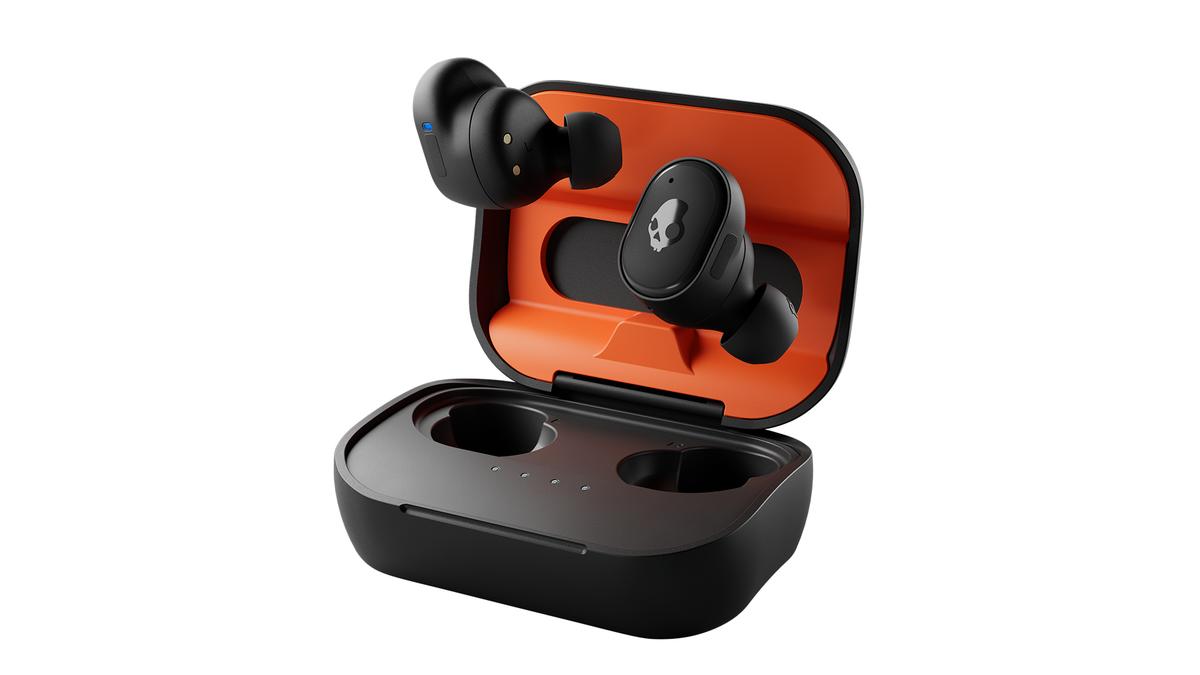 The Skullcandy Grind Fuel earbuds in their orange and black case.