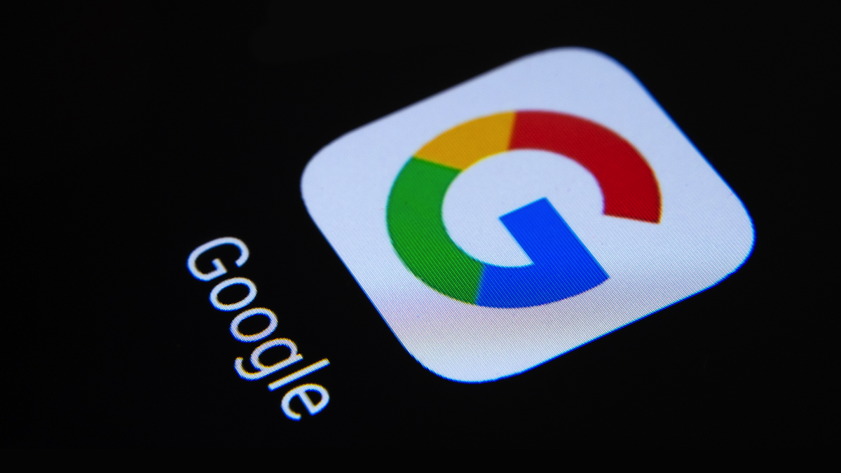 A close-up photo of the Google app's icon on a black background.