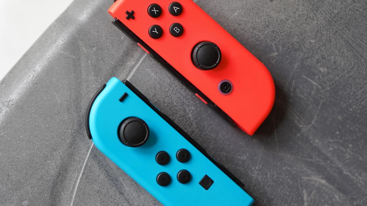A pair of Nintendo Joy-Cons on a table.