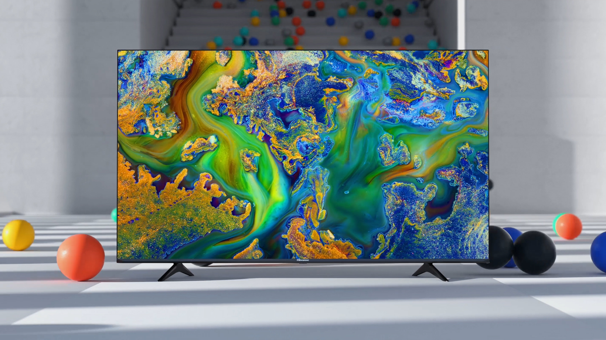 A Hisense ULED 4K TV in a room surrunded by colorful balls. It's a very artsy image.