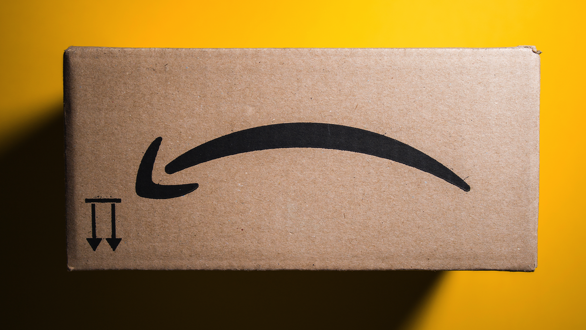 An upside-down Amazon box showing the smiley face logo as a frownie face.