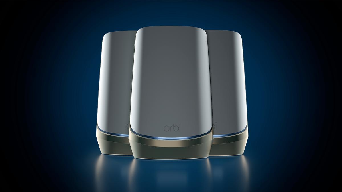 Three Netgear Orbi Quad-band Mesh WiFi 6E mesh Wi-Fi 6E nodes in a black background.
