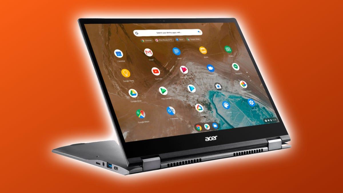Acer Chromebook Spin 713 against orange background