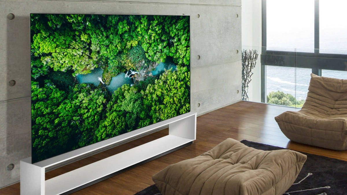 An LG 8K OLED Smart TV against the wall in a living Room.