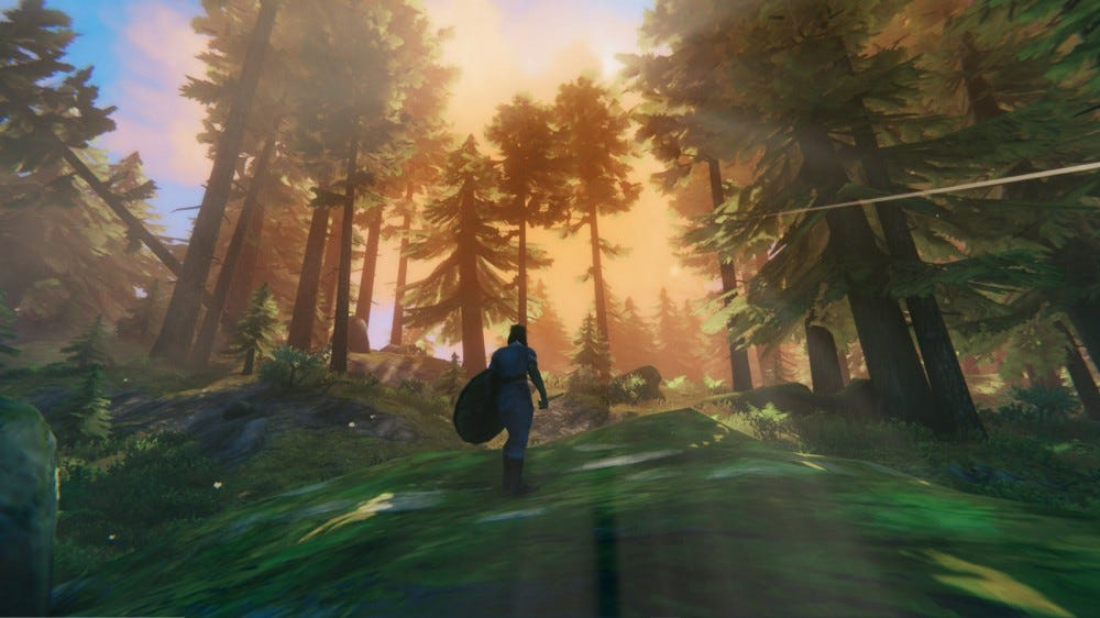 A player character standing in a forest in 'Valheim'