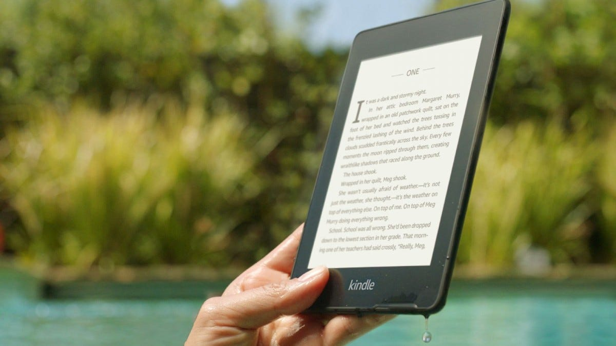 Amazon Kindle Paperwhite dripping with water.