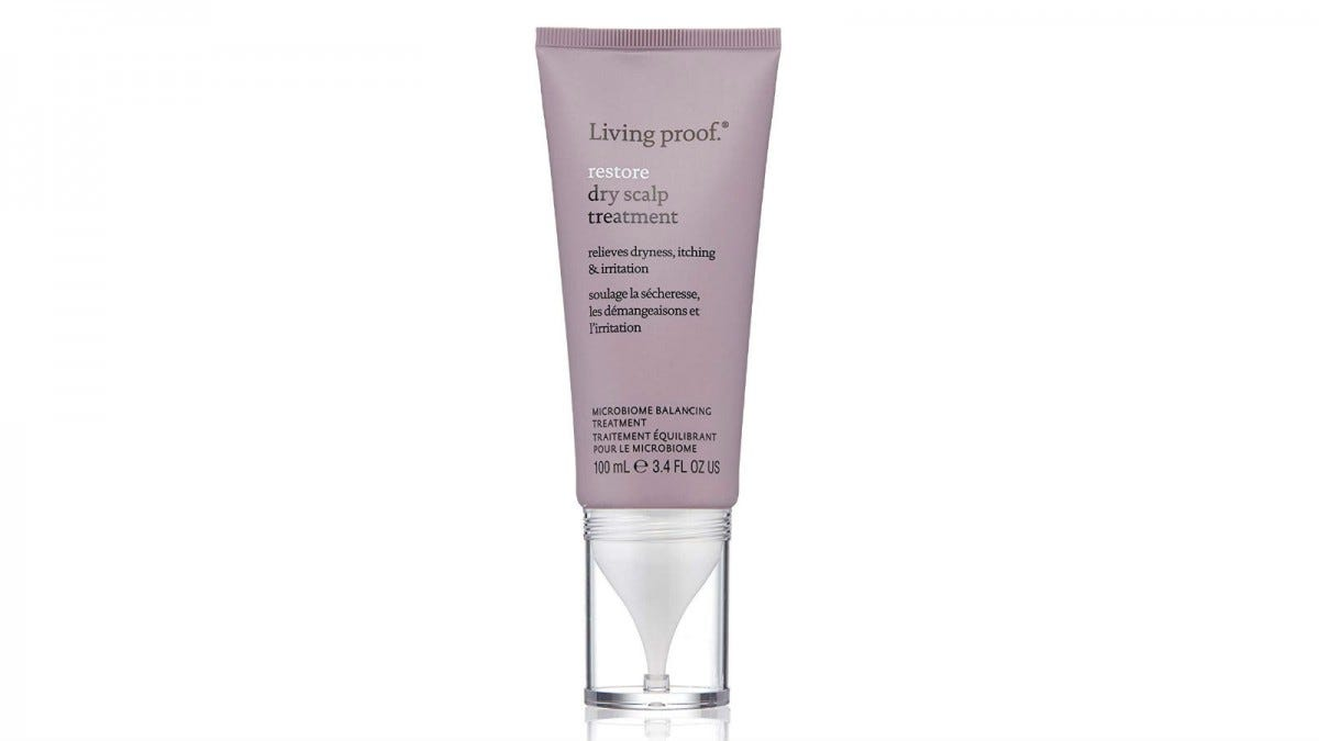 A tube of Living Proof Restore Dry Scalp Treatment.