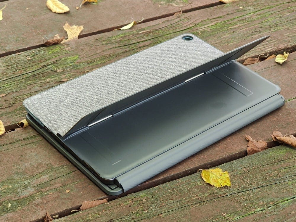 The IdeaPad Duet on a deck, face-down with the kickstand open