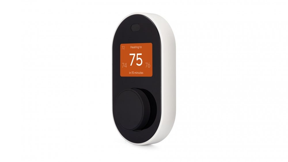 A Wyze thermostat that shows the heating system on