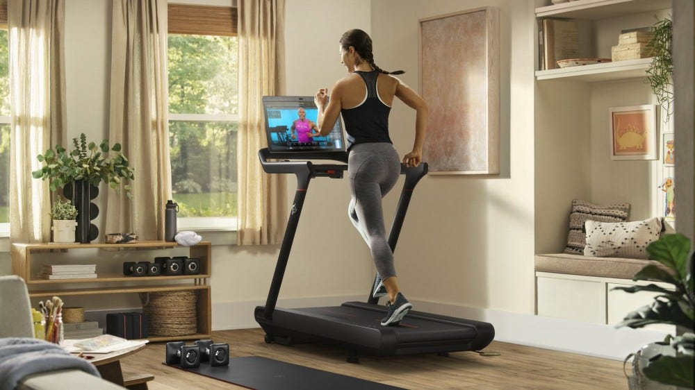 A woman running on a treadmill.