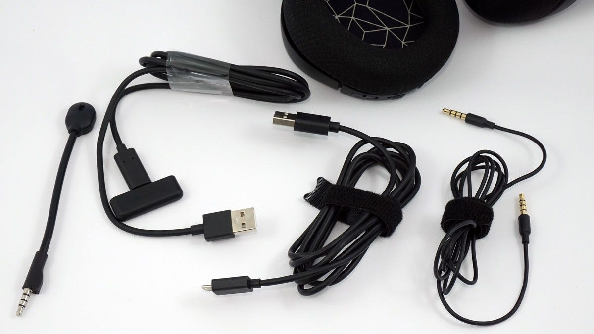 The microphone boom, USB-C dongle, MicroUSB charging cord, USB-A-to-female-C adapter, and standard headphone cable.
