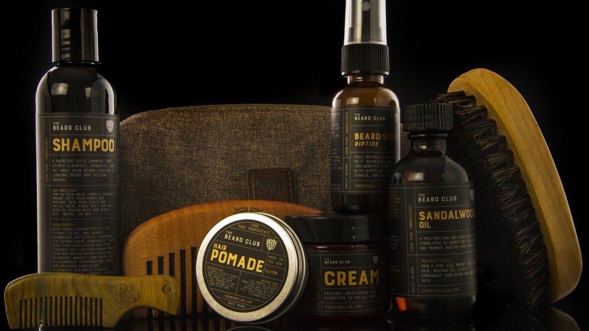 Beard Club shampoo, hair pomade, shaving cream, sandalwood oil, beard spray, two combs, a beard brush, and travel bag.