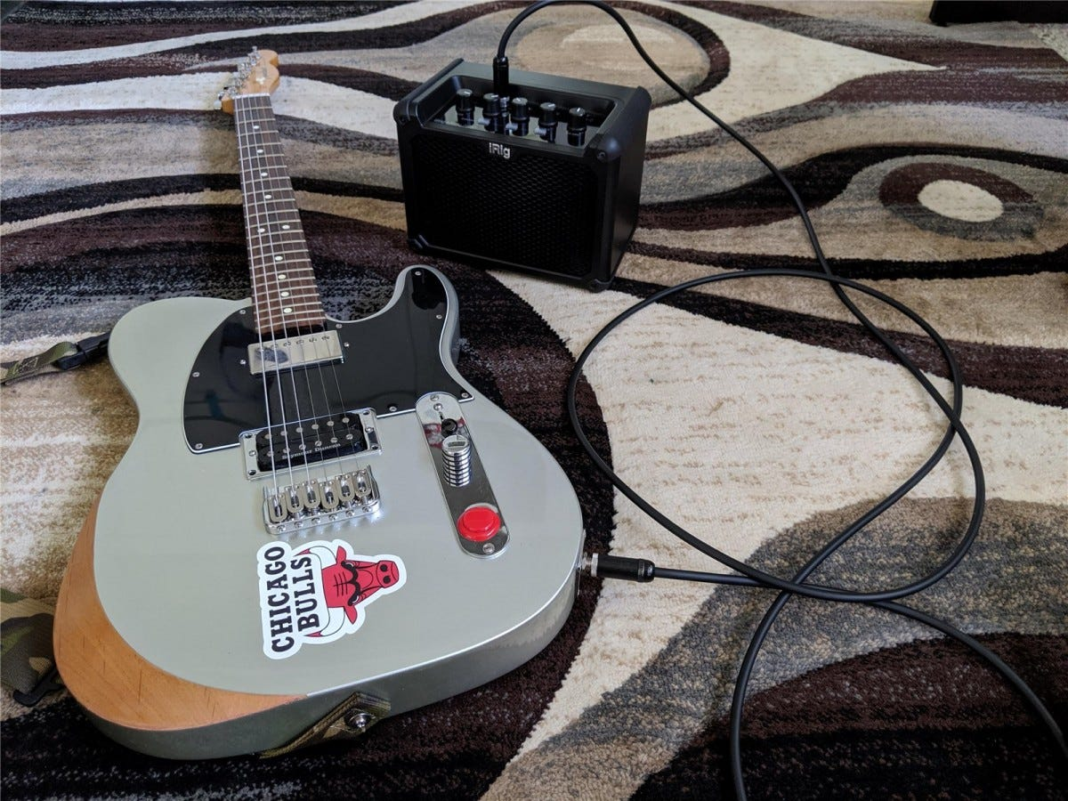The iRig Micro Amp next to a customized Fender Telecaster