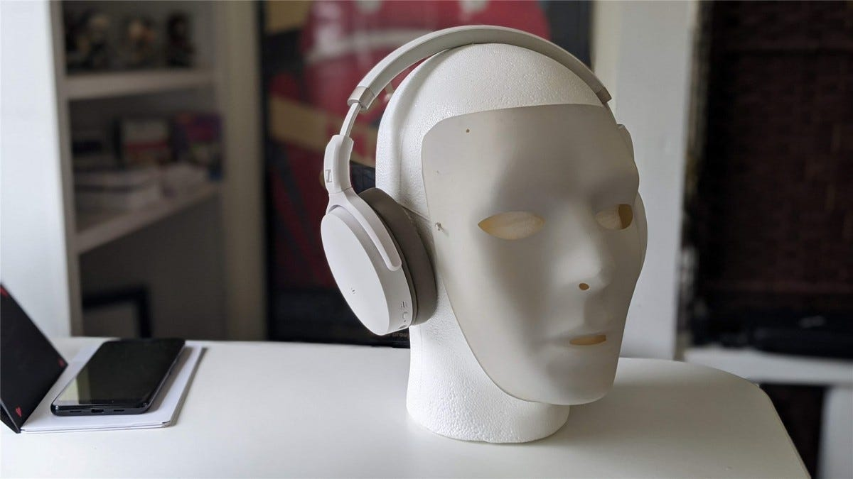 A Styrofoam mannequin head and white mask wearing the Sennheiser HD 450BT headphones