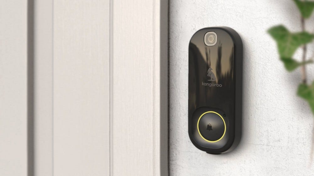 The Kangaroo Doorbell camera on a stucco wall