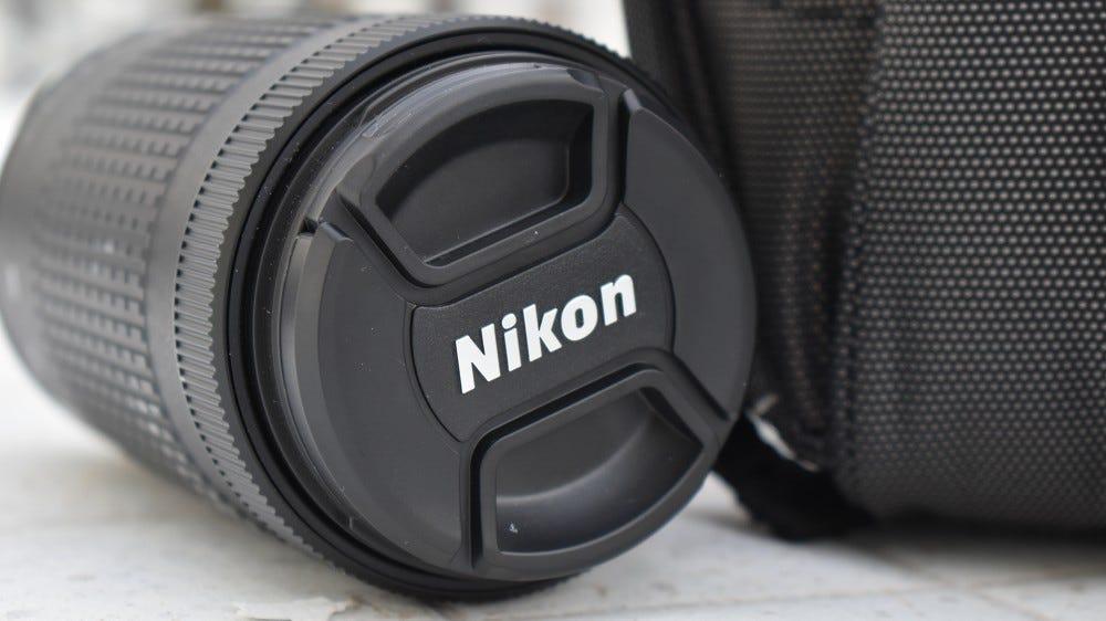 A photo of a Nikon 70-300mm telephoto lens.