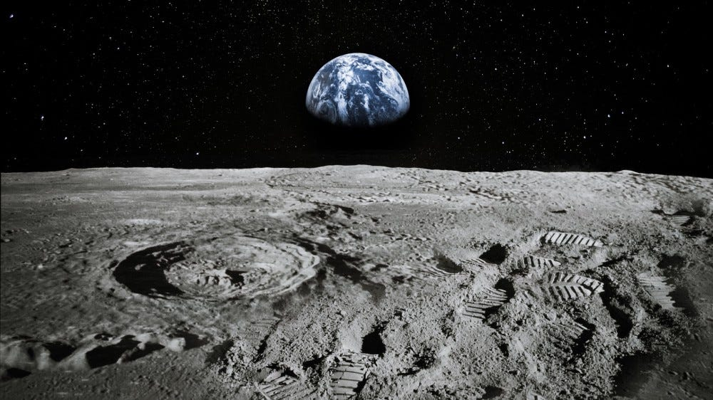 A view of the Earth rising over the Moon's horizong.