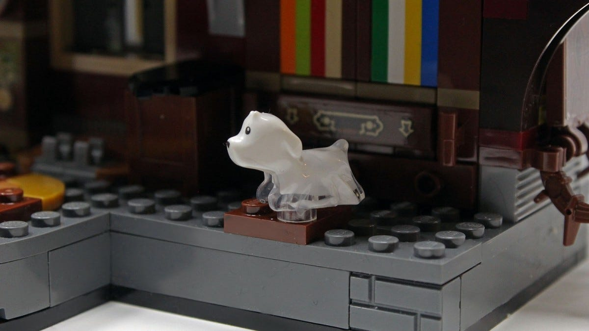 A Ghost Puppy mini-fig, with translucent edges.