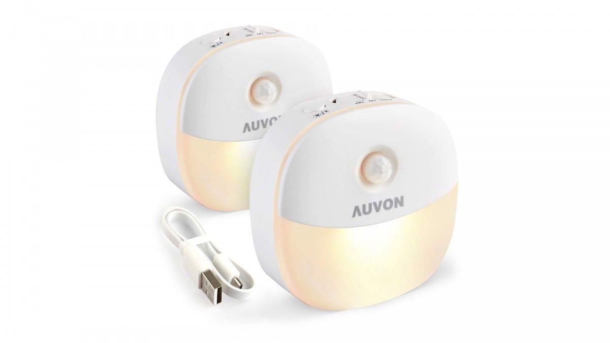 Two AUVON rechargeable motion sensor Puck Lights and USB cord.