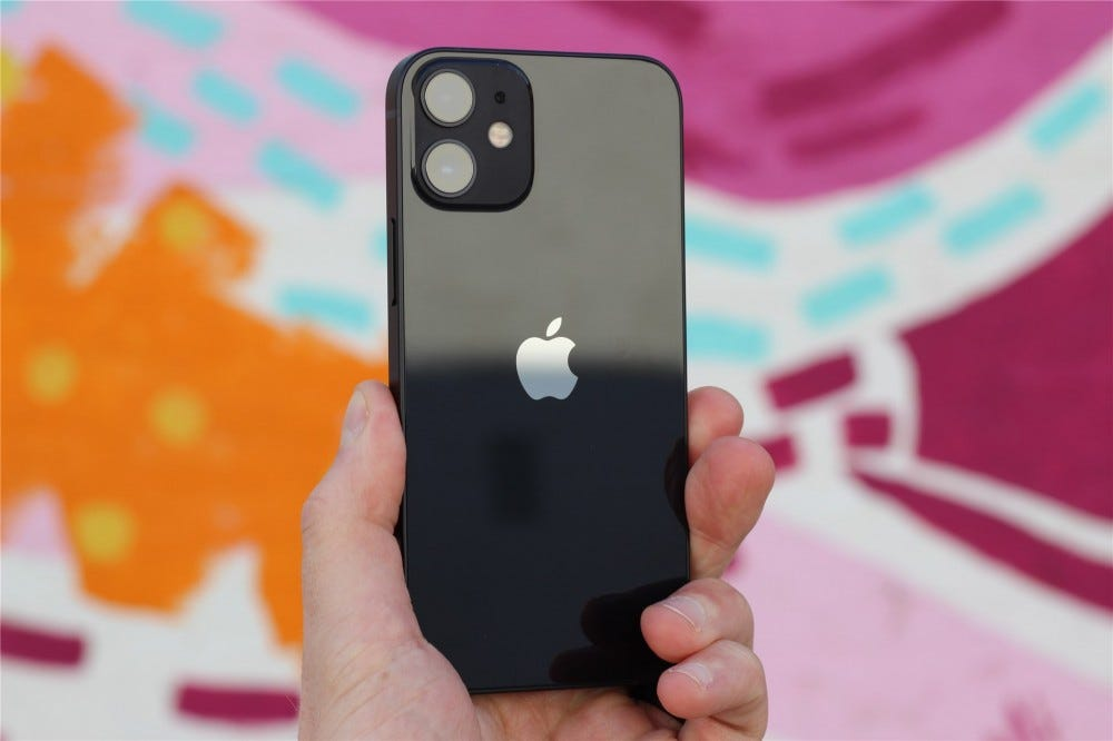 The back of the black iPhone 12 Mini with a colorful background