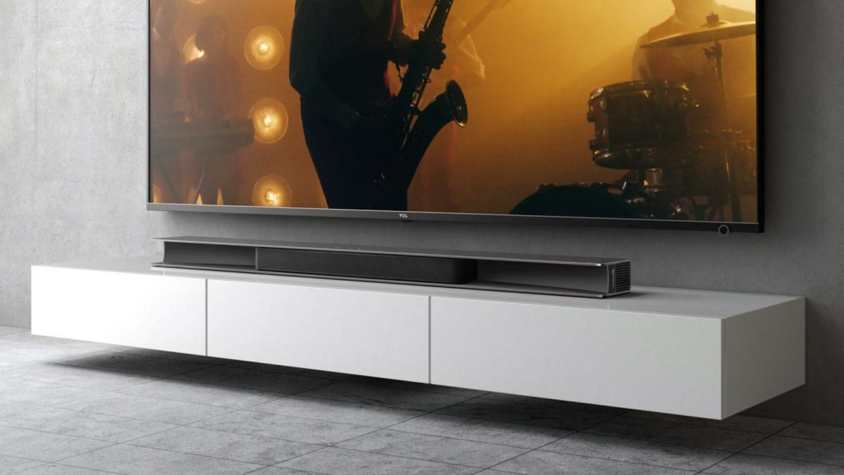 TCL Alto 9 Plus soundbar underneath a TV in the living room