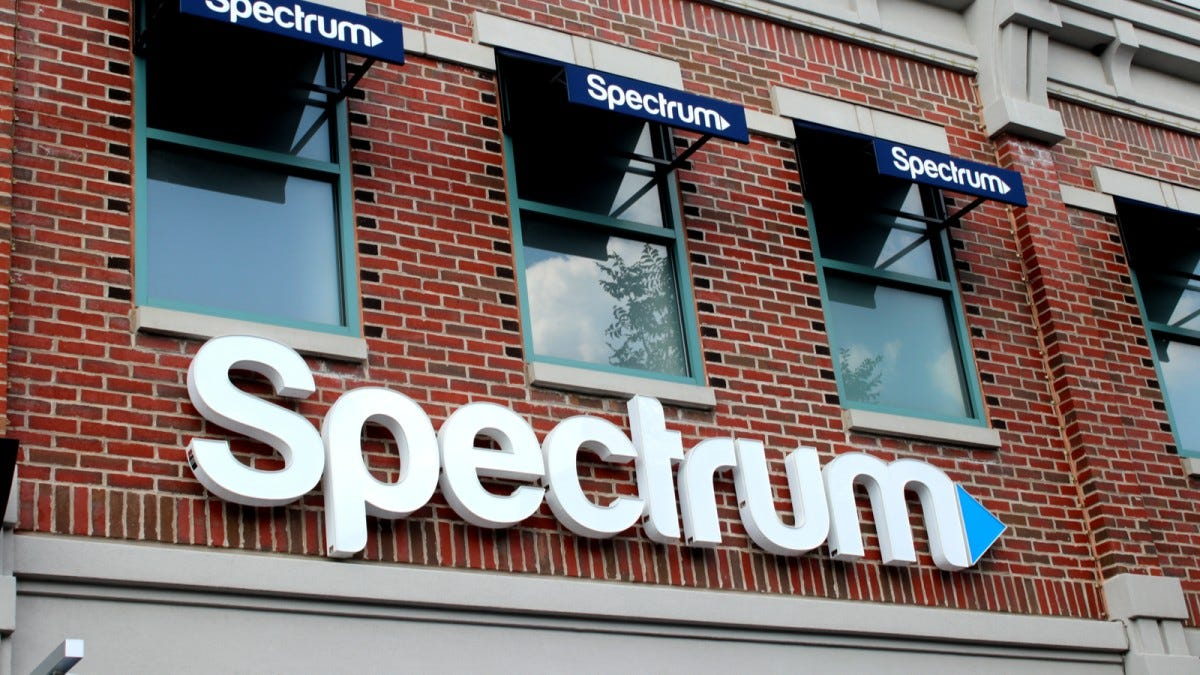 The Spectrum logo on the side of a brick building