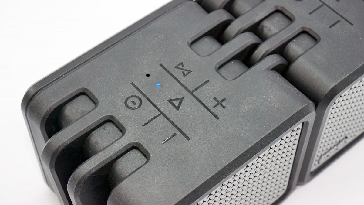 The control buttons on the Zamkol speakers.