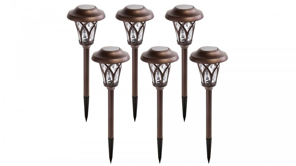 A six-pack of bronze solar powered pathway lights.