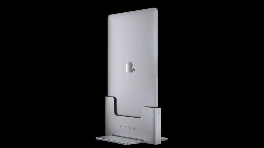 A photo of hte MacBook Pro in a Brydge vertical docking station.