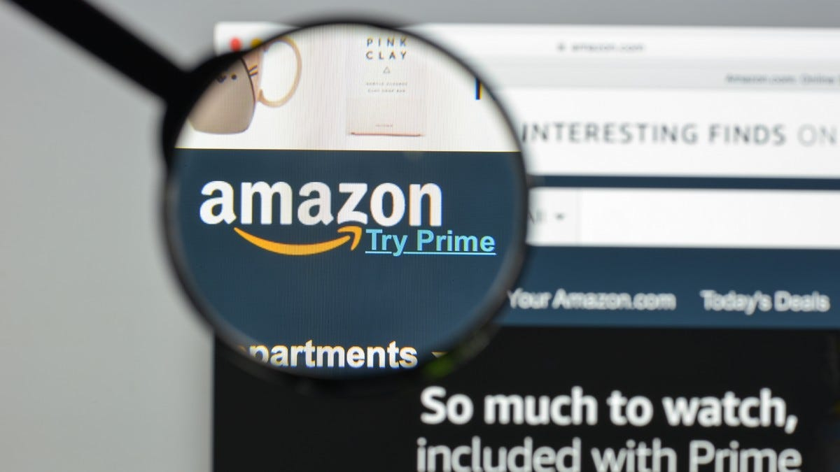 A magnifying glass over the Amazon logo on the Amazon website.