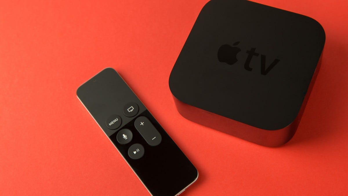 An Apple TV with a remote.