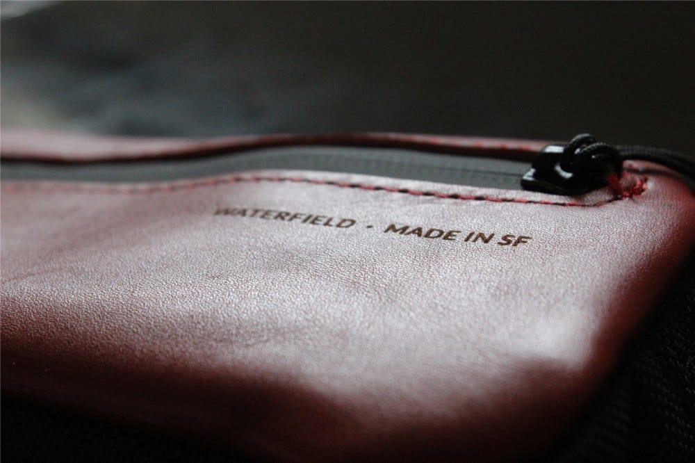 """A macro shot of the """"Waterfield - Made in SF"""" logo on the Crimson Jersey Pocket Tool Case"""