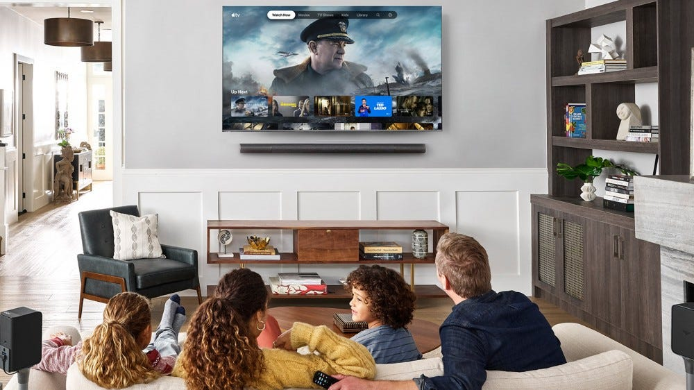 A family watching Apple TV on a Vizio SmartCast television.
